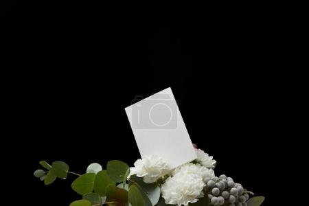 Empty card in spring bouquet isolated on black