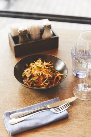 Hot delicious udon noodles with pork on restaurant table