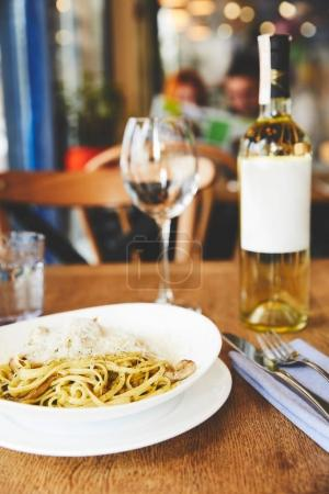 Italian pasta with mushrooms and cheese served with wine