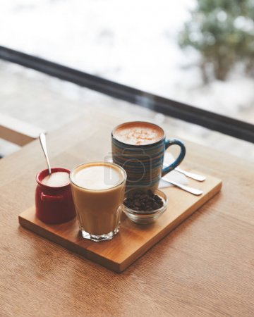 Hot coffee with milk in table in coffee shop