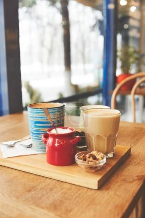 Restaurant table with coffee served in glass and cup