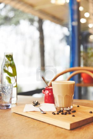 Restaurant table with coffee served in glass