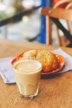 Hot coffee and chocolate chip cookies on plate