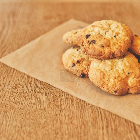Sweet cookies pile on craft paper