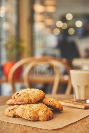 Chocolate chip cookies in cafe on table with coffee