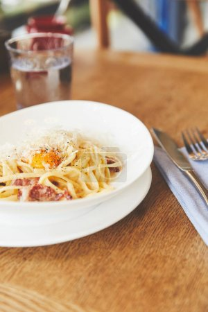 Photo for Italian cuisine dish spaghetti carbonara on restaurant table - Royalty Free Image