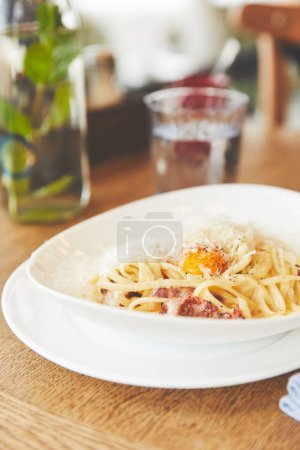 Close-up view of carbonara pasta in white plate