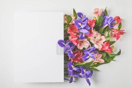 Photo for Top view of blank card and beautiful flower bouquet on grey - Royalty Free Image