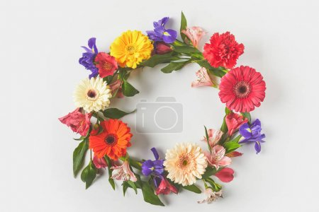 Photo for Top view of floral wreath made of beautiful colorful flowers and green leaves on grey - Royalty Free Image