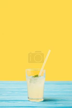 Photo for Fresh cold summer drink in glass with drinking straw on yellow - Royalty Free Image