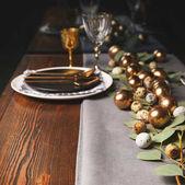 different easter eggs on festive table in restaurant