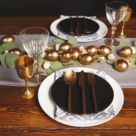 golden utensil and chicken eggs for easter decoration