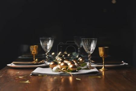 easter golden chicken eggs on wooden festive table in restaurant