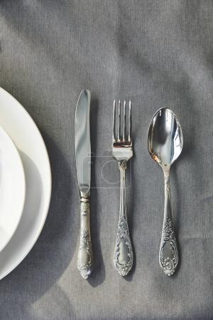 top view of utensil on grey tablecloth