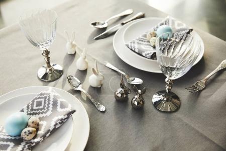 high angle view of easter rabbits and eggs on festive table