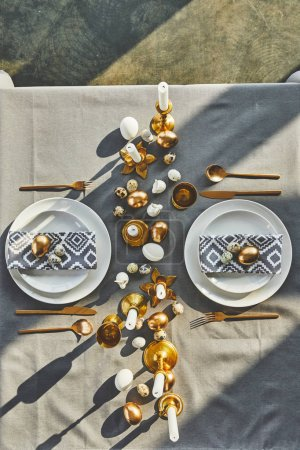 top view of easter eggs and candles on festive table in restaurant