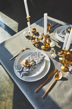 high angle view of beautiful decorated easter table with sunlight