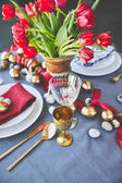 high angle view of easter eggs and tulips on festive table in restaurant