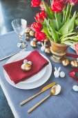 high angle view of easter eggs and flowers on festive table in restaurant
