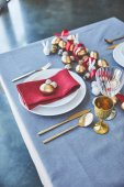 high angle view of easter decorated table with golden eggs and red ribbon