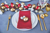 high angle view of easter eggs and napkin on plates