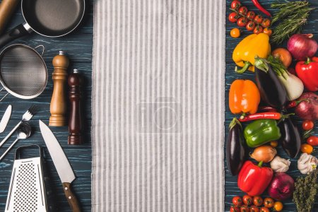 top view of utensil for cooking and vegetables on wooden table