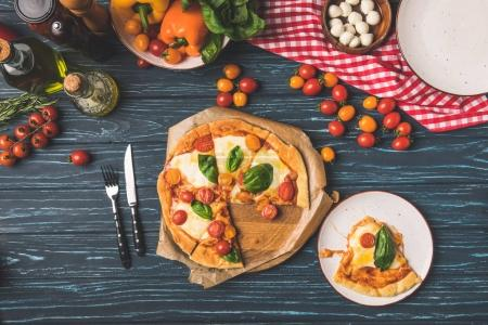 top view of appetizing homemade pizza on table