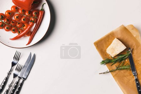 Photo for Top view of vegetables and cheese on white tabletop - Royalty Free Image