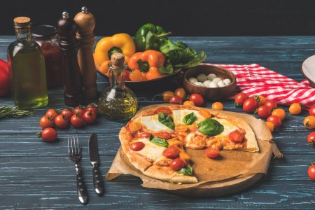 appetizing tasty pizza on cutting board on tabletop