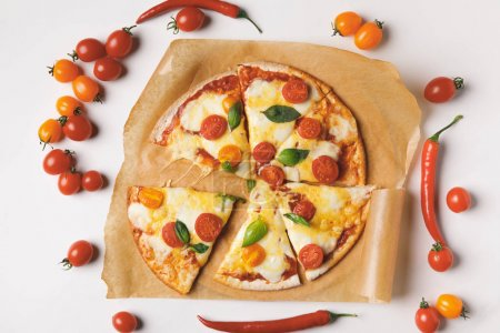 Photo for Top view of appetizing tasty homemade pizza on white table - Royalty Free Image