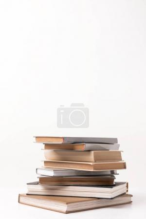 Stack of different books isolated on white