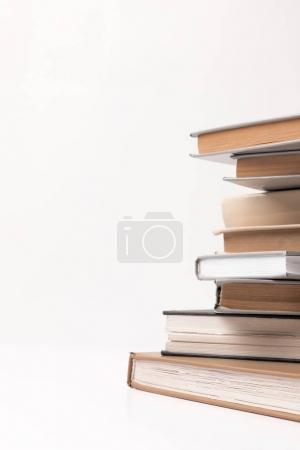 Partial view of stack of different books isolated on white