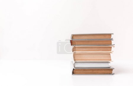 Photo for Stack of different books isolated on white - Royalty Free Image