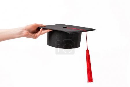Photo pour Vue recadrée de la femelle tenant tasse académique isolé sur blanc - image libre de droit