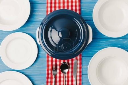 top view of served table with pan on blue table