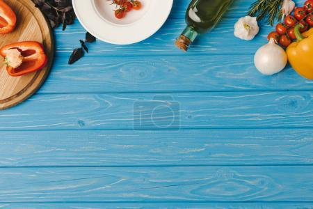 Photo for Top view of ingredients for cooking on blue tabletop - Royalty Free Image