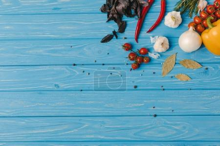 Photo for Top view of vegetables and herbs on blue table - Royalty Free Image