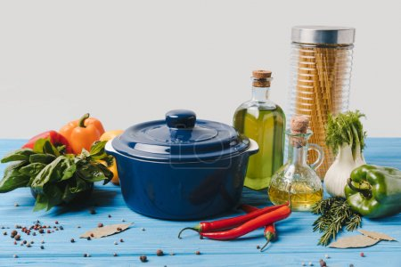 ingredients for cooking pasta with vegetables and pan on table