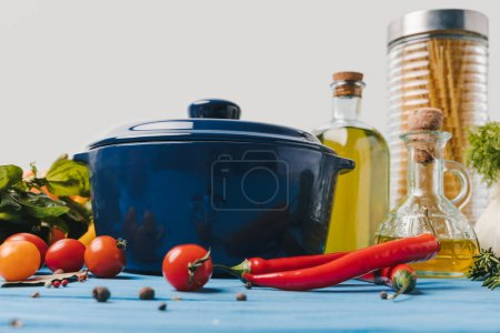 ingredients for pasta preparation with vegetables on table