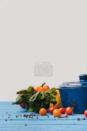 pan with ripe organic vegetables on table