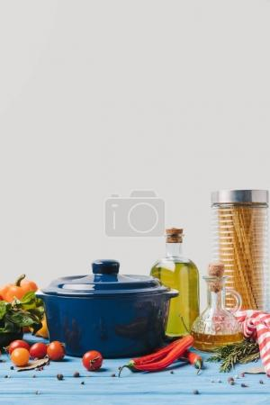 ingredients for cooking pasta with pan and olive oil on table