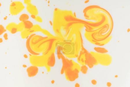 abstract texture with yellow and orange stains