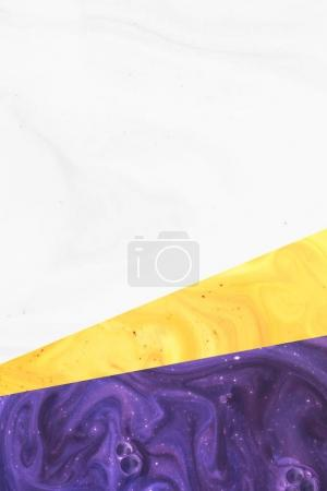 create design with abstract white, yellow and purple paint texture