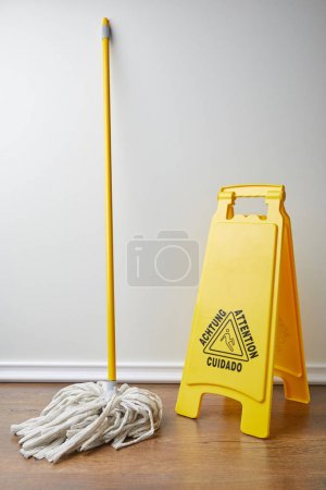 wet floor sign and mop for spring cleaning
