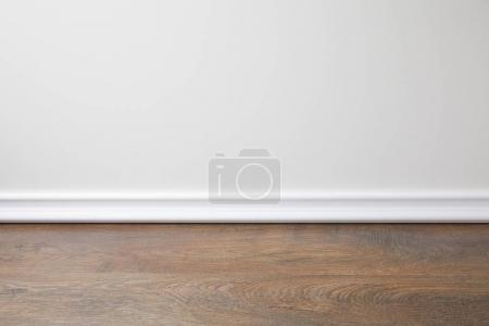 Photo for White wall and wooden floor in apartment - Royalty Free Image