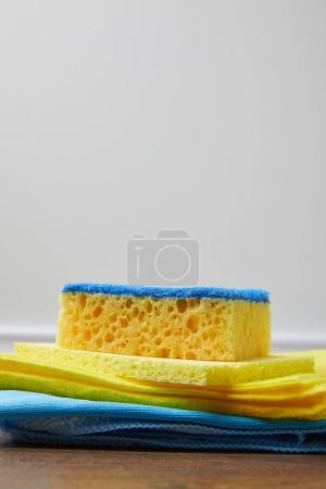 Photo for Yellow and blue rags and washing sponge for spring cleaning - Royalty Free Image
