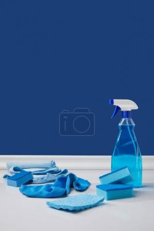 blue spray, rags and washing sponges for spring cleaning