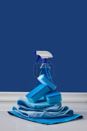 blue sponges, rags and spray for spring cleaning