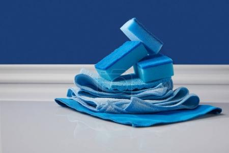 blue sponges and rags for spring cleaning