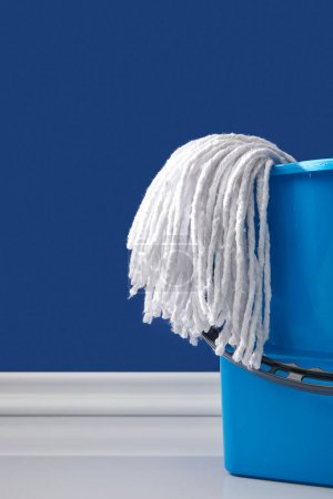 rag and blue bucket for spring cleaning